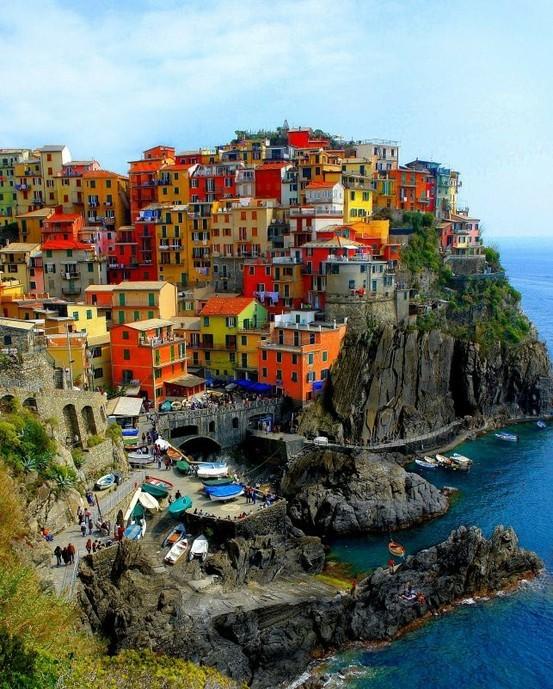 pastel houses on the italian shore photo on sunsurfer