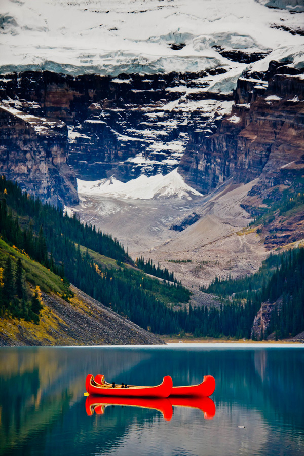 Red canoe on Lake Louise, Alberta, Canada