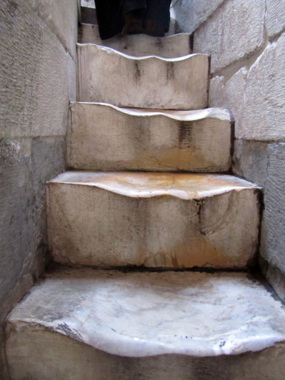 The worn marble steps that lead to the top of the Leaning Tower of Pisa