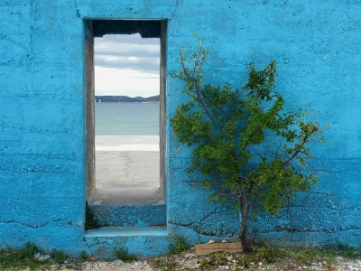 Blue wall and a door to the sea