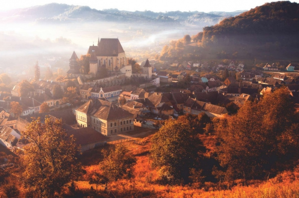 Morning fog over the village of Biertan, Romania